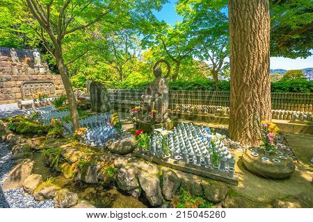 Bronze buddha statue and lots little Jizo Statues in Hase-dera, Kamakura, Japan. Hasedera is one of the largest Buddhist temples in the city. Japanese culture concept
