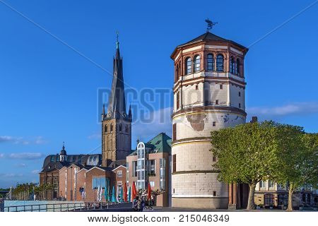 View of Dusseldorf historic center with Old Castle Tower and st Lambertus church Germany
