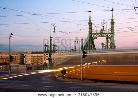 Long exposure photo of tramway in Budapest in Hungary on bridge.
