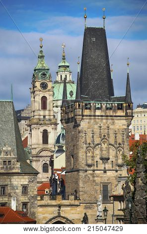View of the Lesser Bridge Tower and Cathedral of Saint Nicolas from the Charles Bridge (Karluv Most) in Prague Czech Republic
