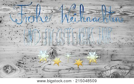 Turquoise And Golden German Calligraphy Frohe Weihnachten Und Ein Gutes Neues Jahr Means Merry Christmas And Happy New Year. Gray Vintage Wooden Background