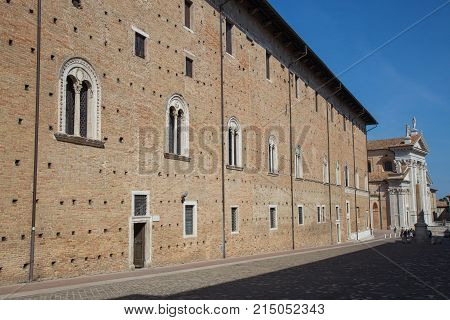 Behind the palazzo ducale and the background the Cathedral of Urbino
