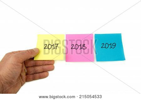 Concept for turn of the year three post it with three years : 2017 2018 2019