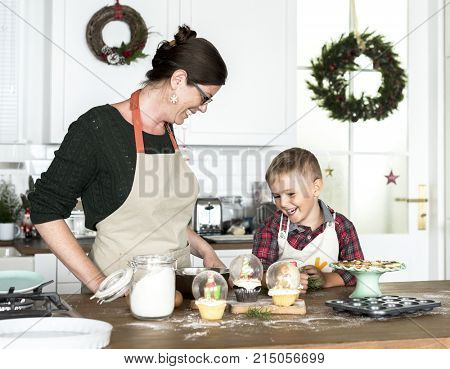 Mother and son baking for Christmas in the kitchen