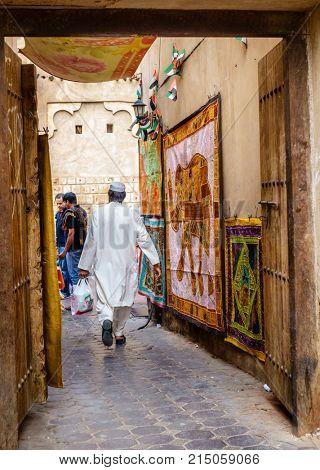 Dubai, UAE, january 29, 2016: Small alley at Dubai Textile Souk in Bur Dubai