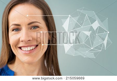 anti-age, people and beauty concept - beautiful middle aged woman with low poly shape and pointers on her face over gray background