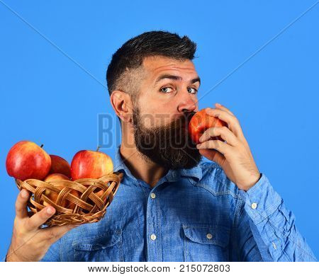 Guy Eats Harvest. Farmer With Calm Face Kisses Red Apple
