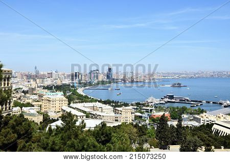 Baku.Azerbaijan.Panorama.View on the coastal bay of the capital on the Caspian Sea.This is the Baku Boulevard it is visited by locals and tourists and along it runs the route of the race stage held every year Formula 1
