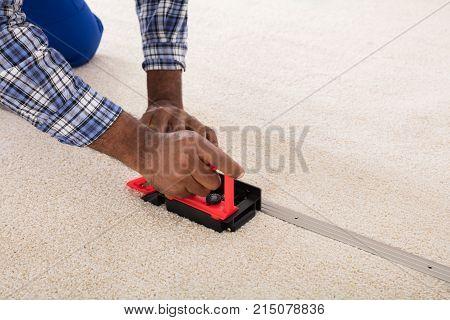 Craftsman Installing Carpet On Floor Using Fitter poster