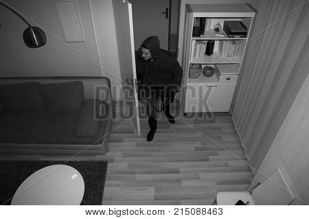 High Angle View Of A Robber Entering In Vacant House