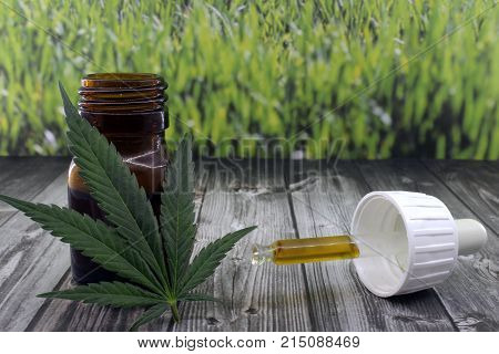 Cannabis oil extract in bottle to soothe pains