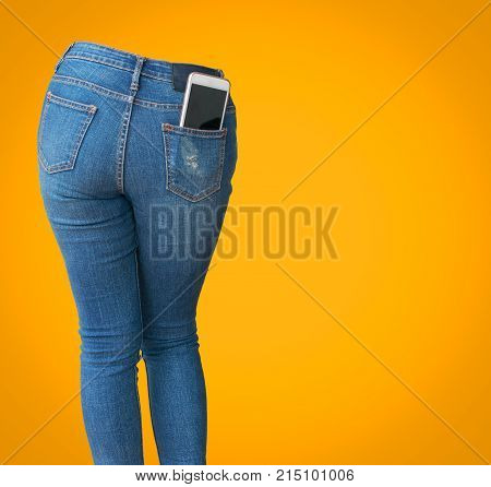 White mobile phone in woman pocket blue jeans