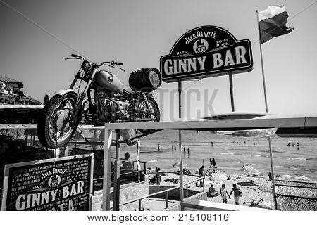 SOZOPOL BULGARIA - AUGUST 24 2017: Ginny Bar on the public beach of an ancient seaside town on the Black Sea Bulgarian Black Sea Coast. Black and white.