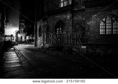 BERLIN - OCTOBER 08 2017: An ancient street in the historical quarter of Nikolaiviertel (Nicholas' Quarter). Black and white.