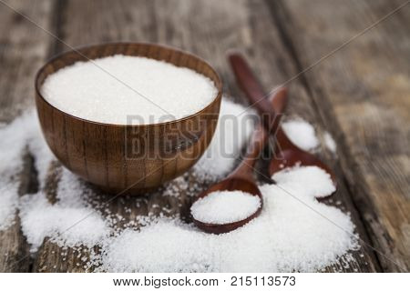 Bowl With Sugar And A Wooden Spoons