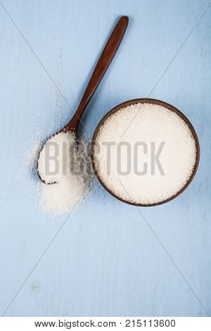 Sugar In A  Bowl And A Spoon