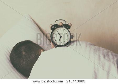 A young man postpones the moment of awakening