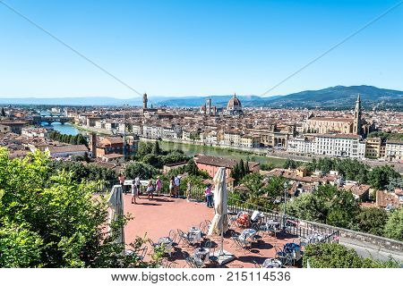 Florence, Italy - August 23, 2016:  Florence Cityscape from Michelangelo Piazzale. The square is dedicated to the Renaissance sculptor and is a famous tourist attraction