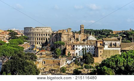Panoramic view of Rome Italy with the Colosseum and ruins of the Forum Romanum.