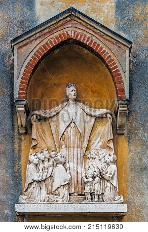 PADUA, ITALY - AUGUST 06, 2017: Monument to St. Maddalena di Canossa (1774-1835) on the facade of the Institute of her name. St. Maddalena foundress of the two Canossian orders was beatified in 1988.