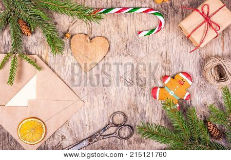 Christmas decoration with fir tree gift packing envelope toy and gingerbread. Preparing for Christmas.