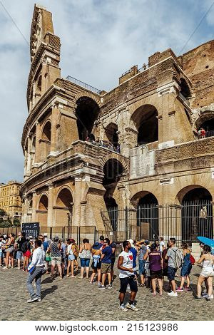 ROME - AUGUST 10, 2017: Turists waiting for entry to the Colosseum, the largest amphitheatre ever built, built in the years 72-80 under the Flavian dynasty emperors Vespasian and his successor Titus.