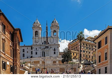 ROME - AUGUST 11, 2017: The Spanish Steps the monumental stairway of 135 steps designed by architects Francesco de Sanctis and Alessandro Specchi, links Piazza di Spagna with Piazza Trinita dei Monti.