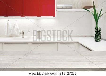Blurred background of modern kitchen with tabletop and copy space