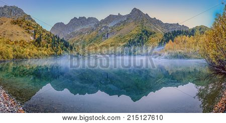 Autumn Lake Kardyvach is a mirror image of the Caucasian Biosphere Reserve. Near Sochi, Russia