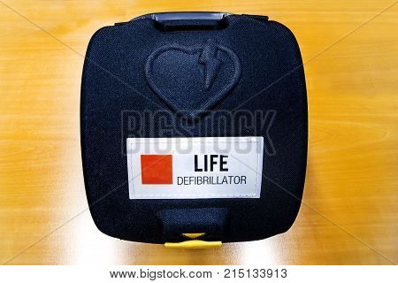 Life defibrillator Automatic External hart defibrillator pack on the wooden color office desk