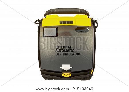 Life defibrillator Automatic External heart defibrillator pack on the wooden color office desk