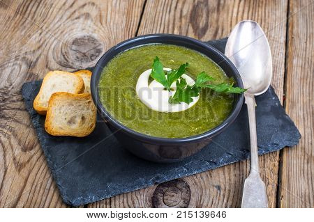 Diet and healthy food. Soup puree from green vegetables. Studio Photo
