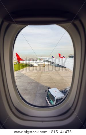 ISTANBUL TURKEY - MARCH 12 2016: view of the takeoff field through the porthole at Ataturk Airport. Istanbul TURKEY March 12 2016