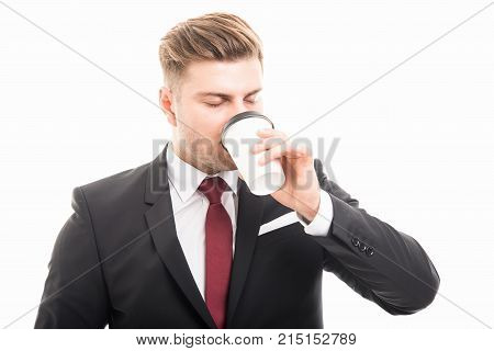 Business Man Standing Sipping Takeaway Coffee