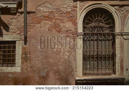 Window with grates belonging to an old decadent building ruined by time