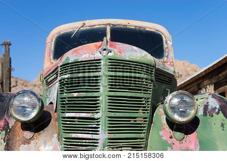 November 9, 2015 Nelson, Nevada, USA: front end closeup of a vintage abandoned classic truck in the desert