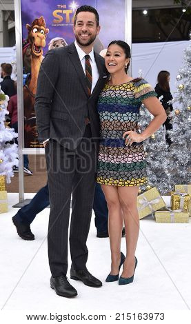 LOS ANGELES - NOV 12:  Zachary Levi and Gina Rodriguez arrives for the 'The Star' World Premiere on November 12, 2017 in Westwood, CA