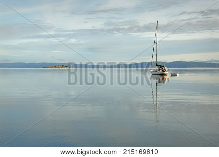 Gulf Islands Sailboat, British Columbia. A calm anchorage in the Gulf Islands, British Columbia.