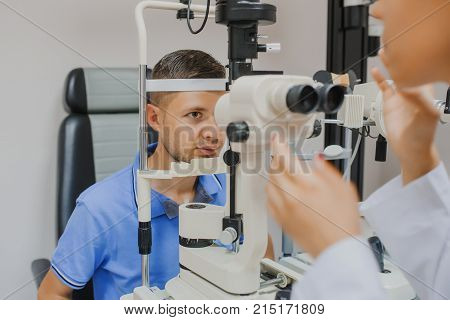 Young Beautiful Woman Doctor/eye Specialist/optometrist In An Ophthalmologic Clinic