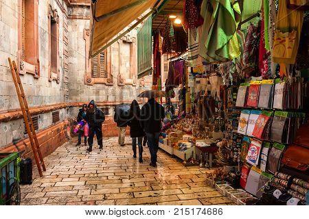 JERUSALEM, ISRAEL - NOVEMBER 2011: Tourists on Via Dolorosa famous street path of Jesus