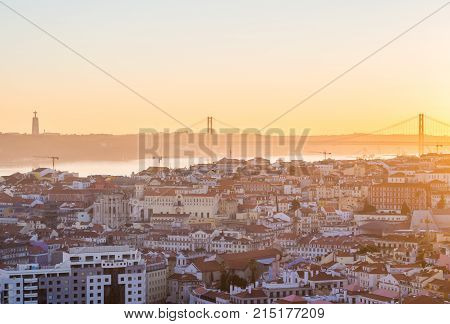 LISBON PORTUGAL - NOVEMBER 19 2017: Cityscape of Lisbon Portugal at sunset on a November day as seen from Belvedere of Our Lady of the Hill viewpoint.