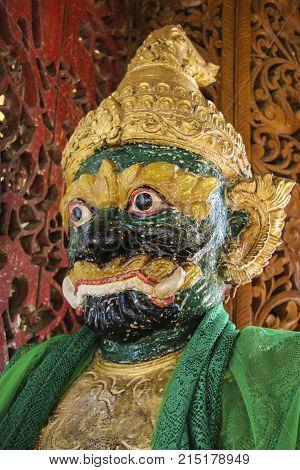 Figure guardian in Kyauktan Ye Pagoda Yangon river tributary Myanmar (Burma)