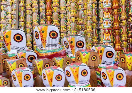 Wooden owls artworks of handicraft on display during Handicraft Fair in Kolkata - the biggest handicrafts fair in Asia.
