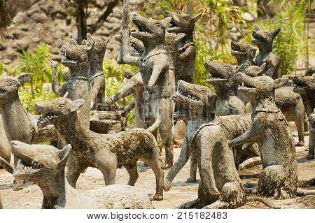 NONG KHAI, THAILAND - APRIL 15, 2010: Exterior of the dog sculptures in Sala Kaew Ku Sculpture Park in Nong Khai, Thailand.