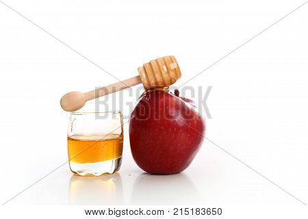 tasty red apple with sweet honey in studio white background