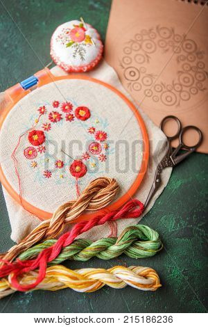 Set with embroidery in the process the embroidery frame linen cloth scheme embroidery thread scissors embroidered knitting head