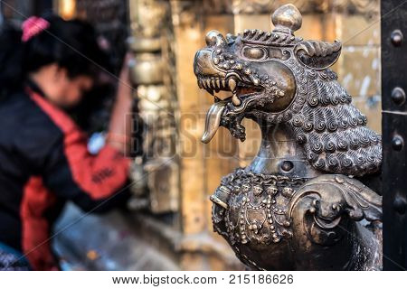 Close-up photo of lion bronze head statue at Bhaktapur Durbar Square, Nepal
