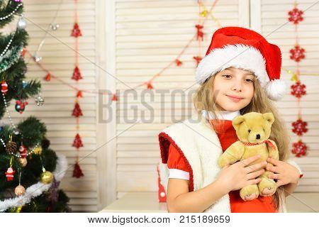 Santa Claus Kid At Christmas Tree.
