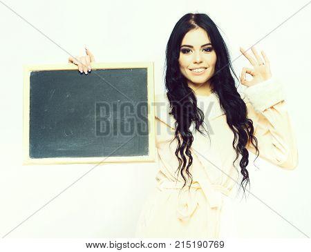 Sexy Smiling Girl In Beige Velour Bathrobe Holding Board