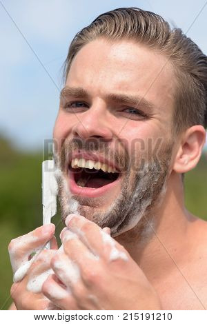 Beauty And Healthcare Concept: Man With Bristle Shaving